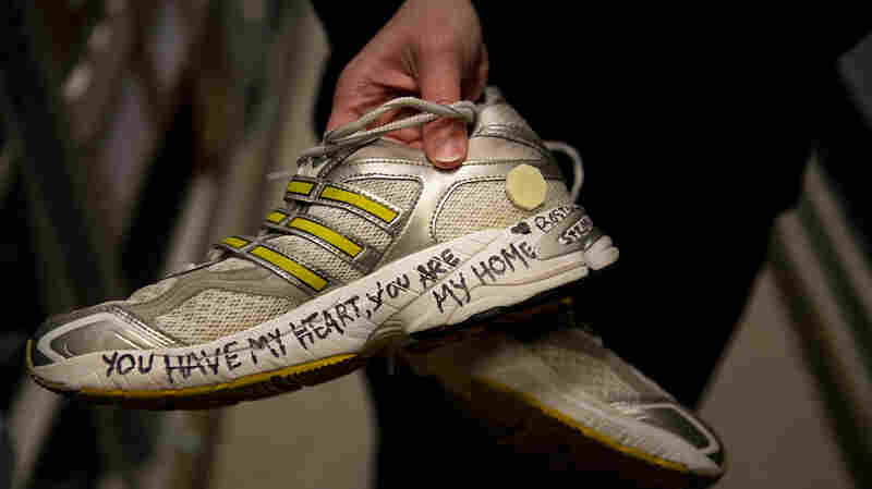 A pair of running shoes left at the Boston Marathon memorial last year.