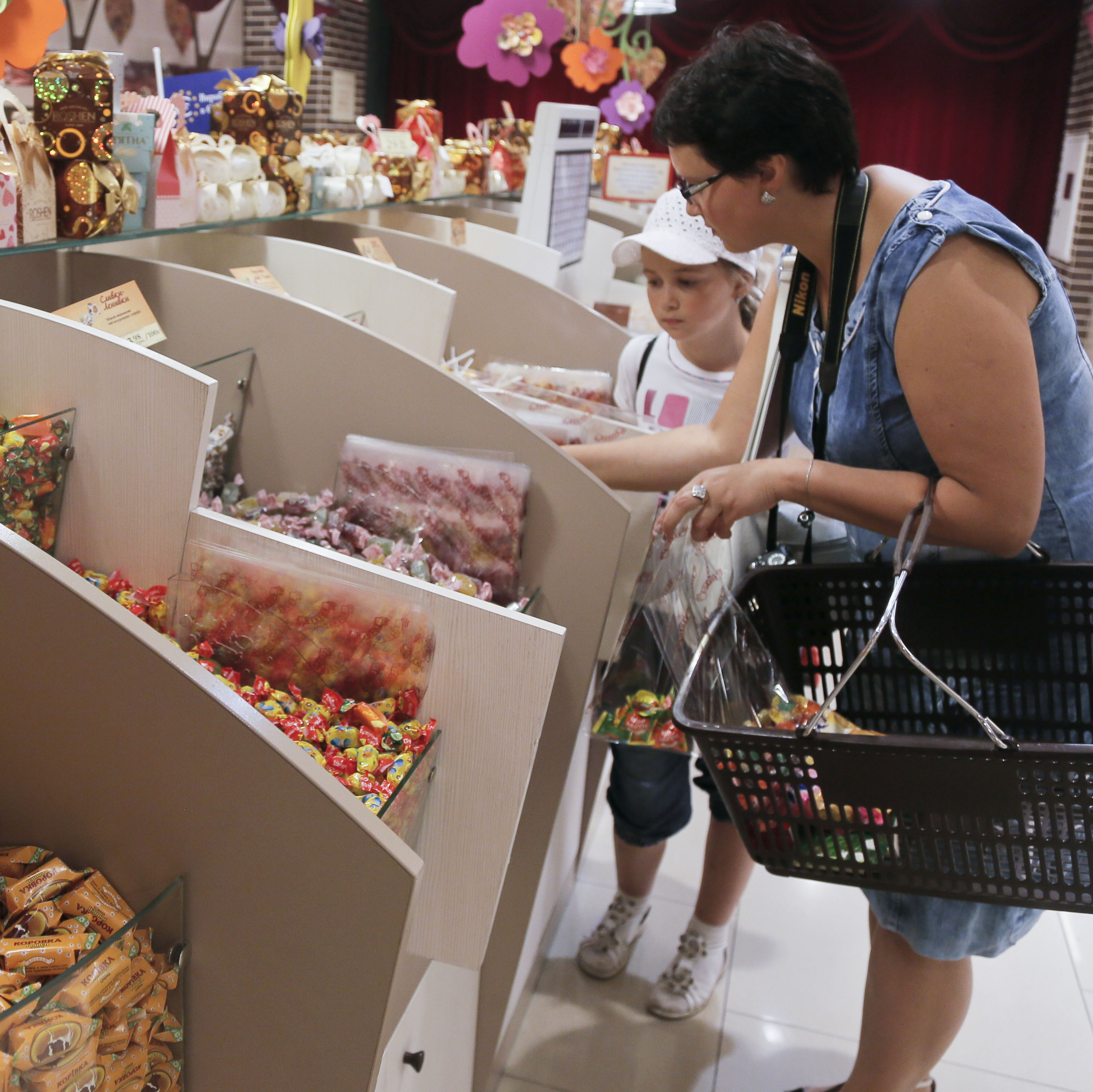 Visitors buy candies at a Roshen's shop in Kiev, Ukraine, in 2013.