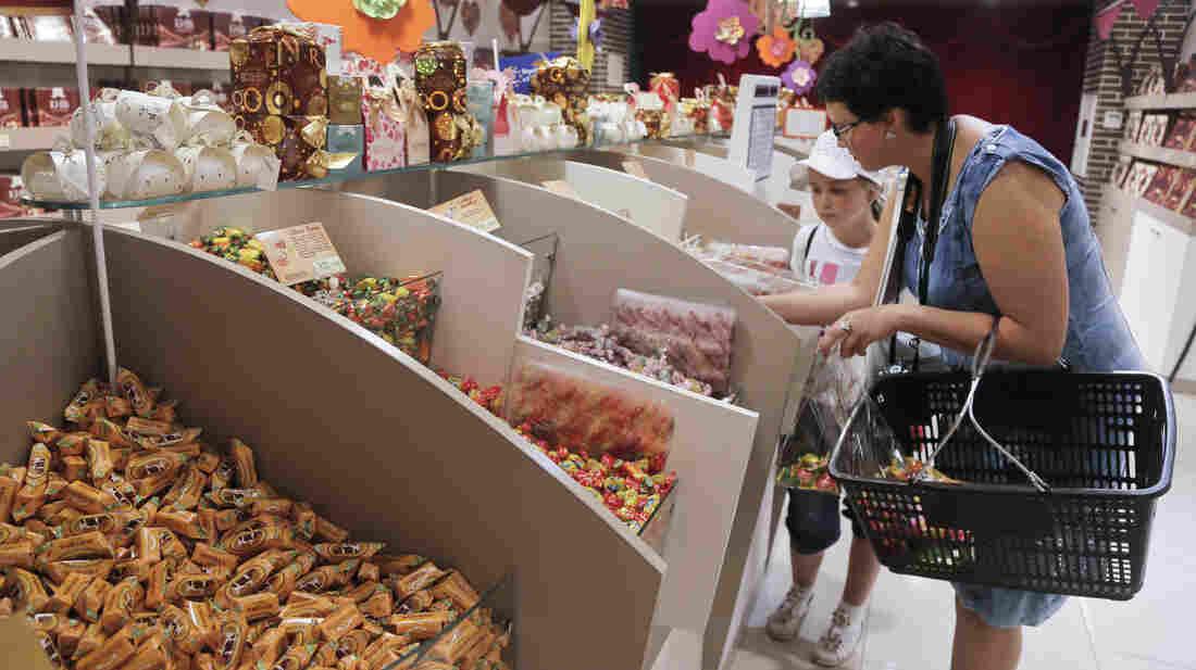 Visitors buy candies at a Roshen's shop in Kiev, Ukraine, in 2013.
