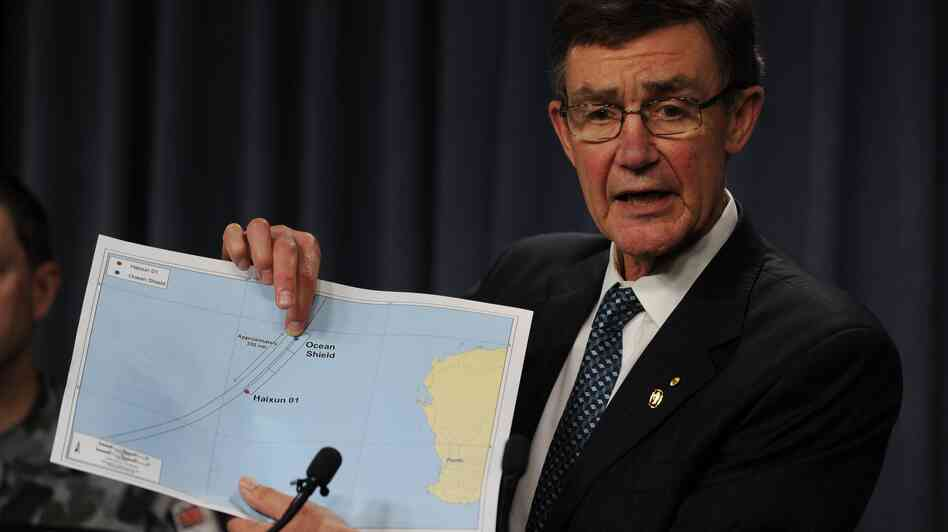 "Angus Houston displays a map of the search area for missing Malaysia Airlines flight MH370 Monday. Houston says an Australian navy ship has detected underwater signals consistent with aircraft black boxes, calling it the ""most promising lead"" so far in the month-old search."