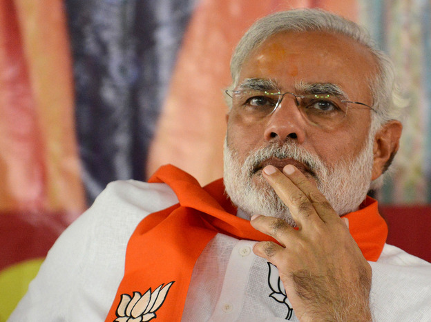 Narendra Modi, leader of the Bharatiya Janata Party, attends an April 5 rally in Gandhinagar, India. Modi, a Hindu nationalist, is seen as a strong contender to become the next prime minister, though critics say his policies would divide the country's Hindus and Muslims.