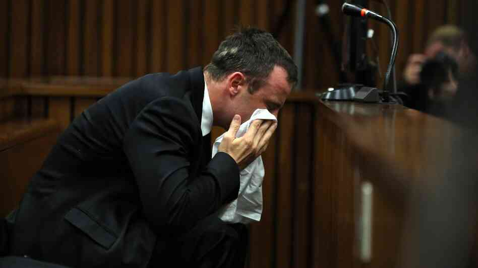 South African track star Oscar Pistorius wipes his face during his trial in Pretoria on Monday. The 27-year-old grew emotional as he apologized to the family of girlfriend Reeva Steenkamp. Pistorius is charged with murdering her.