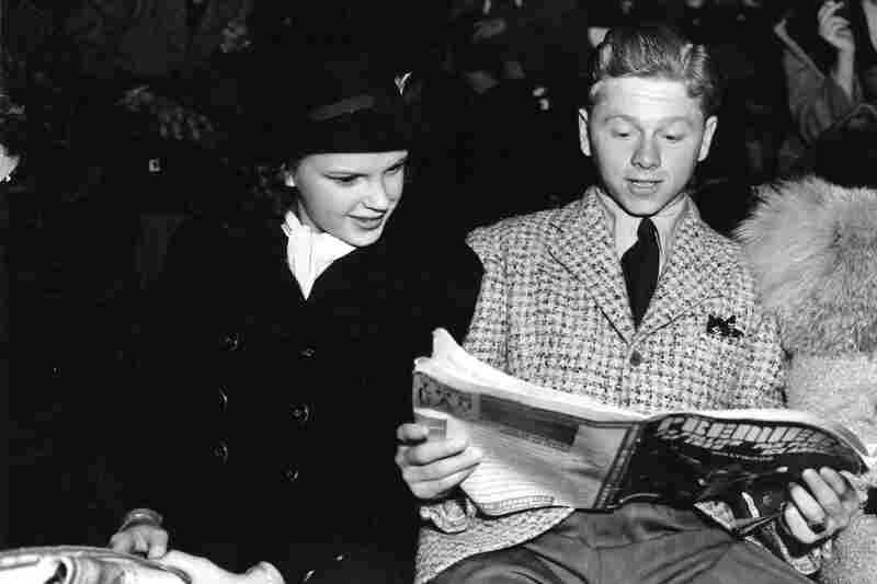 Rooney and Judy Garland look over the program at the Ice Follies. The two starred together on screen and developed a friendship.