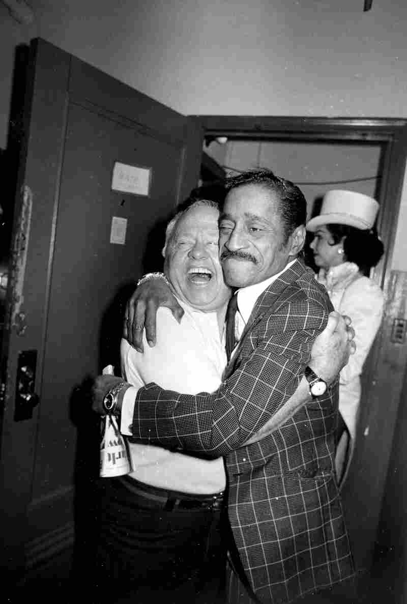 Rooney gets a hug from entertainer Sammy Davis Jr. during intermission of Rooney's Broadway musical comedy revue Sugar Babies in 1981.