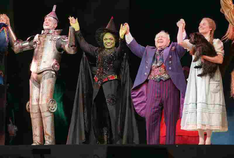 Rooney joins cast members Dirk Lumbard (left), Eartha Kitt and Caroline McMahon during the opening performance curtain call for The Wizard of Oz in 1998, at New York's Madison Square Garden. Rooney played the lead role in the stage production.