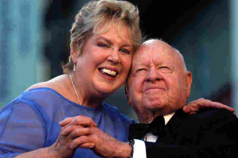Jan and Mickey Rooney pose for photographs after unveiling their star on the Hollywood Walk of Fame in Los Angeles in 2004.