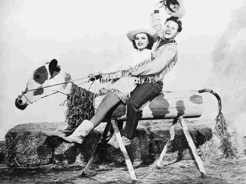 Mickey Rooney starred with Judy Garland in the 1943 movie musical Girl Crazy. The duo's onscreen chemistry reflected their off-screen friendship.
