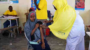 A pregnant Somali woman gets a tetanus shot at a clinic in Mogadishu in 2013. The vaccination initiative was launched by the GAVI Alliance, UNICEF and the World Health Organization.