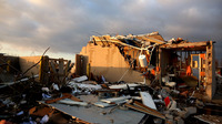 About 1,000 homes were damaged or destroyed by a tornado in Washington, Ill., last November. Some senators are pushing for a better disaster formula for communities to get financial help.