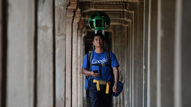 "A Cambodian technician carries a backpack-mounted ""Trekker"" device housing 15 cameras as he demonstrates the technique used to digitally map the Angkor complex in Cambodia. (AFP/Getty Images)"