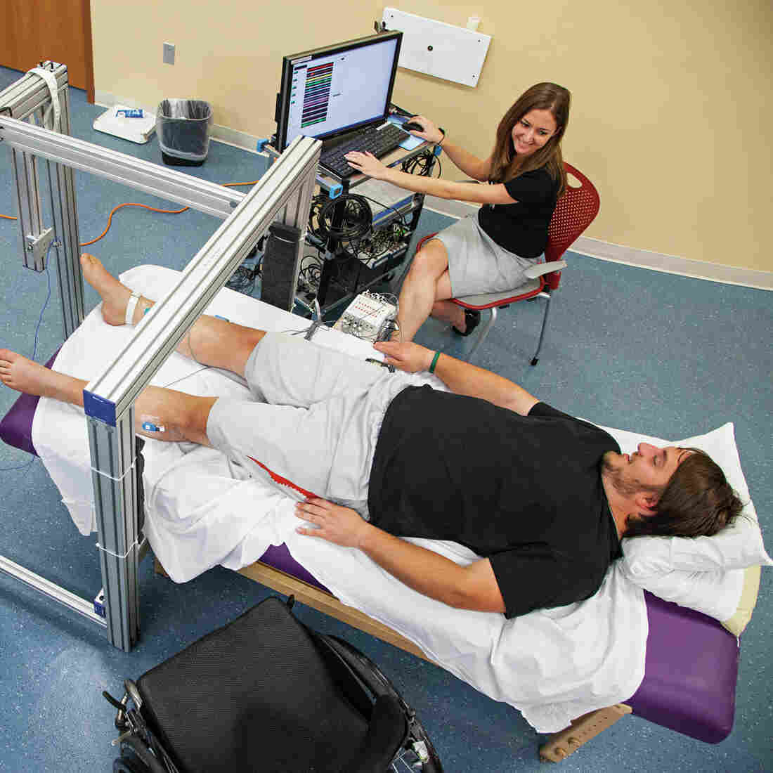 Kent Stephenson, a research participant at the University of Louisville's Kentucky Spinal Cord Injury Research Center, has his level of muscle activity and force measured by Katelyn Gurley.