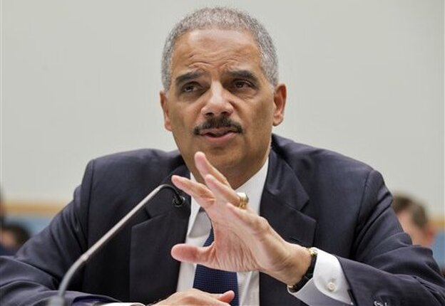 Attorney General Eric Holder played the asparagus card against one of his House Republican tormenters.
