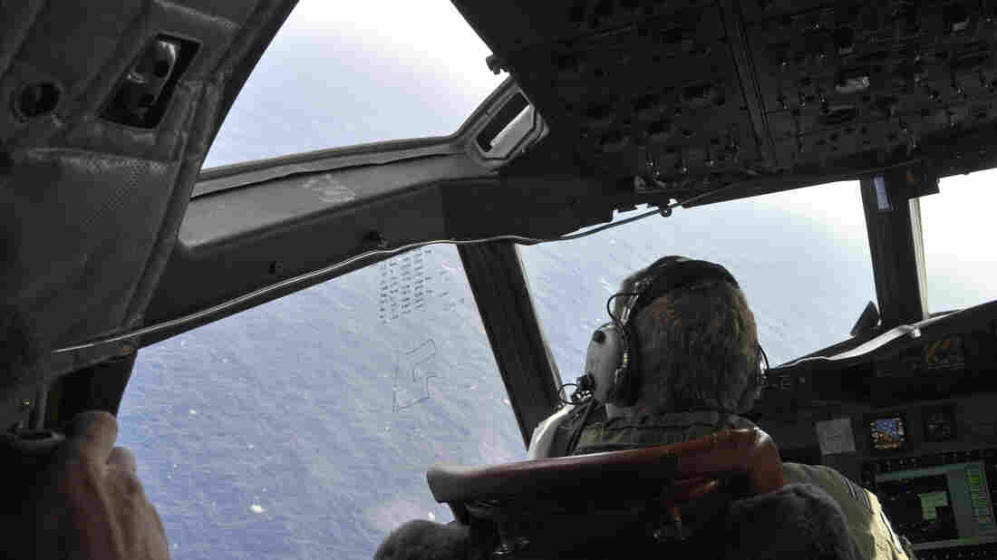 A crewman on a Royal New Zealand Air Force P-3 Orion searches for possible debris from the missing Malaysia Airlines Flight 370, in the southern Indian Ocean earlier this month.