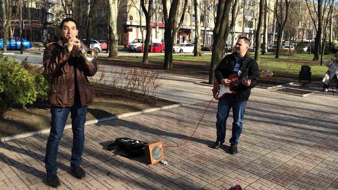 Unfazed by the political turmoil a few blocks away, street musicians in Donetsk play Adele songs on Pushkin Boulevard.