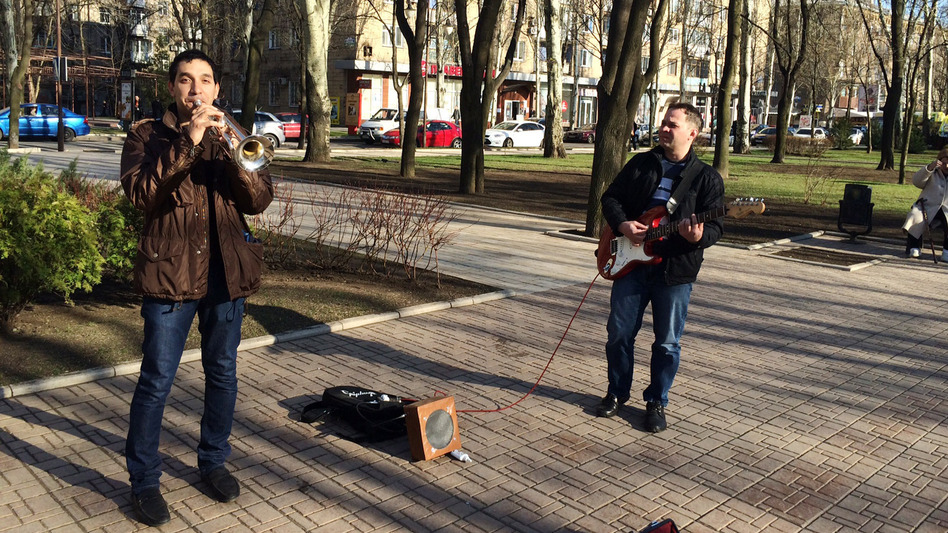 Unfazed by the political turmoil a few blocks away, street musicians in Donetsk play Adele songs on Pushkin Boulevard. (Ari Shapiro/NPR)