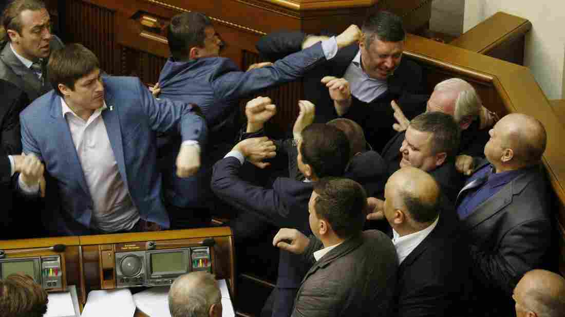 Members of Ukraine's Svoboda party fight with members of the Communist Party in Ukraine's Parliament Tuesday, during a debate over a law toughening responsibility for separatism.