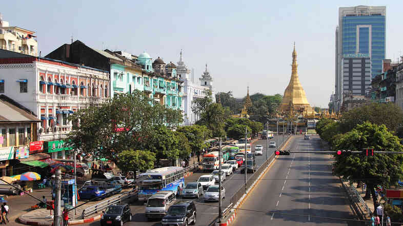At the center of Yangon, the city's colonial heritage, Buddhist faith and emerging modern face are visible in a single block.