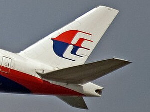 Logo of Malaysia Airlines on one of its fleet.