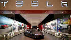 Tesla stores, like this one in Miami, sell cars directly to customers, bypassing dealerships. Tesla has had to fight to keep its stores open in some locations, most recently in New Jersey.