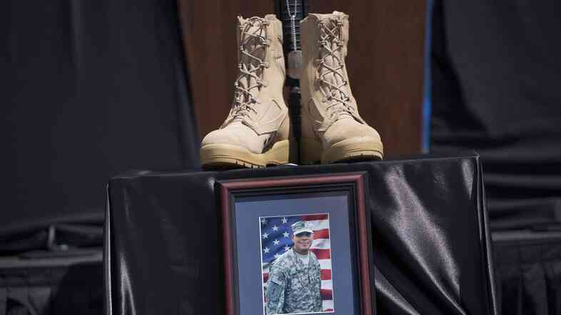 A memorial for Staff Sgt. Carlos Lazaney Rodriguez is seen before a service at Fort Hood on Wednesday.