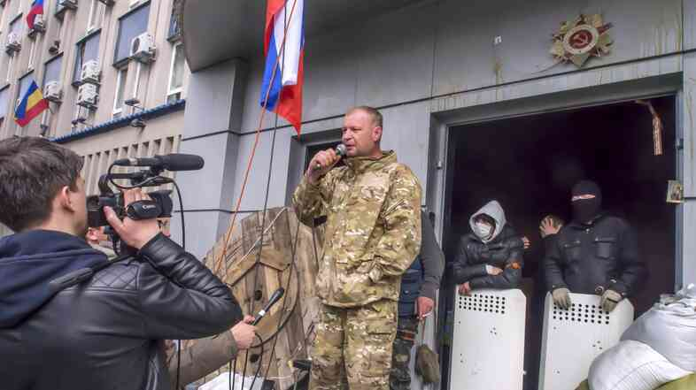 A pro-Russian activist speaks at the Security Services building, which was seized in Luhansk, eastern Ukraine. The standoff is one of three taking place in the region, and Luhansk is considered particularly volatile because the Security Services building contains many weapons.