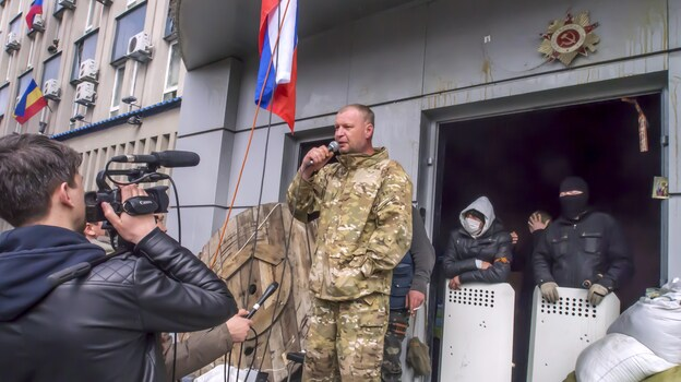 A pro-Russian activist speaks at the Security Services building, which was seized in Luhansk, eastern Ukraine. The standoff is one of three taking place in the region, and Luhansk is considered particularly volatile because the Security Services building contains many weapons. (AFP/Getty Images)