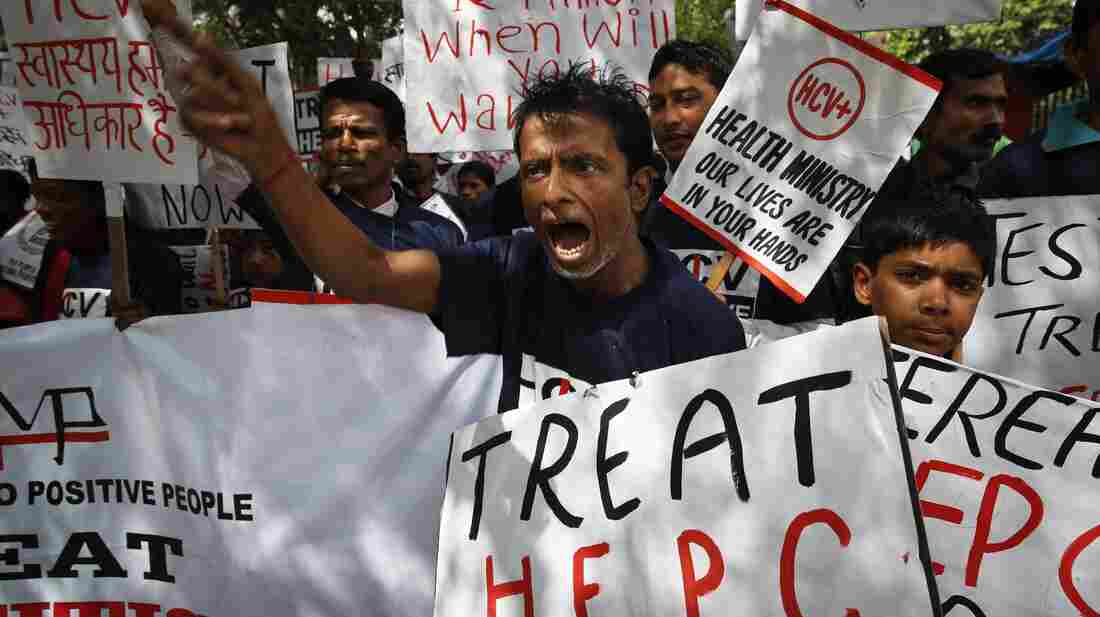 Advocates demonstrate in favor of cheaper generic drugs to treat hepatitis C in New Delhi on March 21. The disease is common among people who are HIV positive.