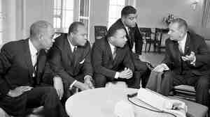 President Lyndon Johnson talks with civil rights leaders in his White House office on Jan. 18, 1964. The black leaders, from left, are, Roy Wilkins, James Farmer, Dr. Martin Luther King Jr., and Whitney Young.