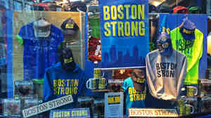 The phrase Boston Strong sprang up after last year's marathon bombings and is now ubiquitous around town. But some wonder if the commercialization of the slogan also trivializes the tragedy.