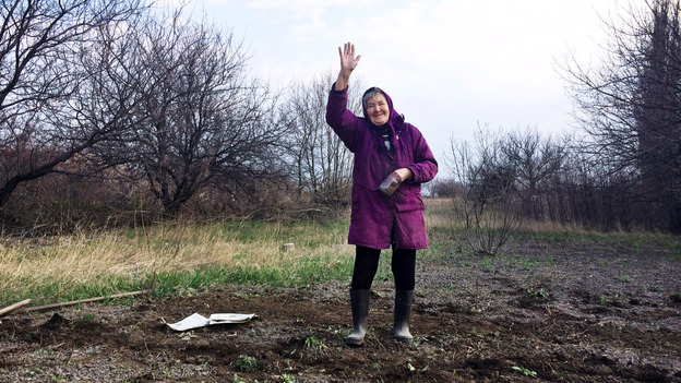 "In the rundown Ukrainian town of Perewalsk, near the Russian border, 80-year-old Lida Vasilivna has just planted a garden. ""Business just went belly up,"" she says about her town's hard times, after asking, ""Are you gonna put this granny on TV?"" (Ari Shapiro/NPR)"