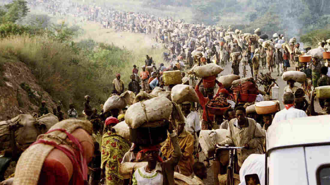 Rwandan refugees cross the border into Tanzania on May 30, 1994.