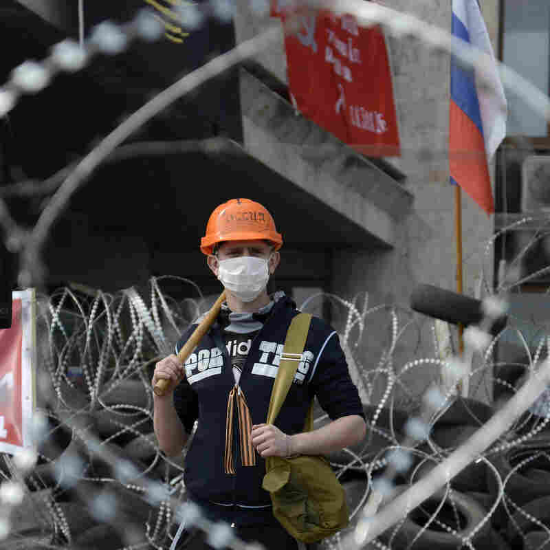 A pro-Russia protester stands at a barricade outside a regional government building in Donetsk, Ukraine, on Wednesday.