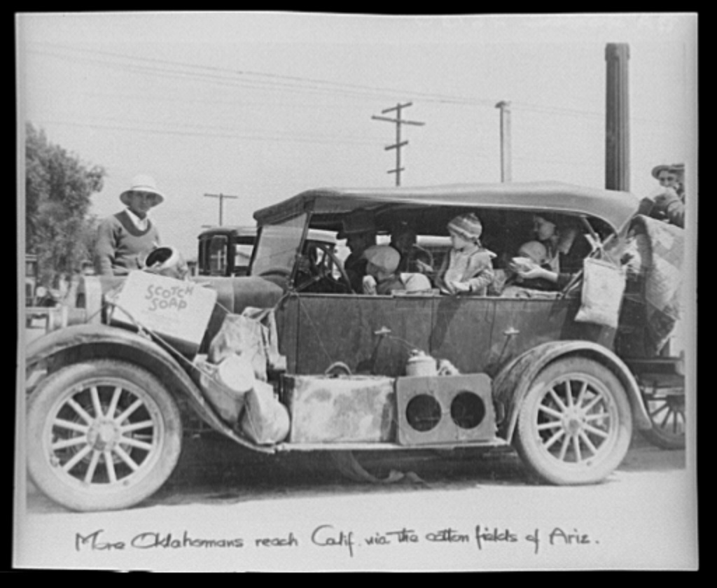 "Oklahoma Dust Bowl refugees in San Fernando, Calif. (1935) Steinbeck writes: ""Suddenly they were nervous. Got to get out quick now. Can't wait. We can't wait. And ... frantically they loaded up the cars and drove away, drove in the dust. The dust hung in the air for a long time after the loaded cars had passed."""