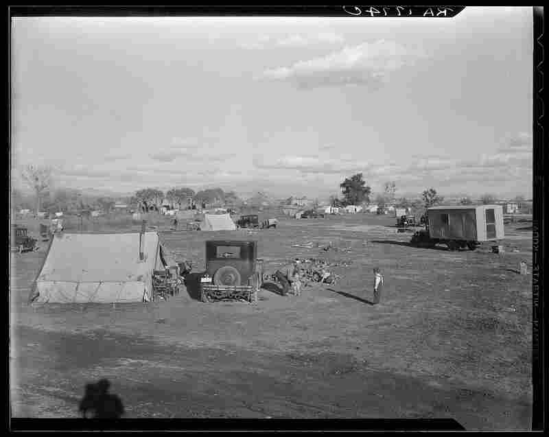 """Dust Bowl families paid 50 cents a week to stay at this auto camp north of Calipatria, Calif. (1937) Steinbeck writes: """"Because they were lonely and perplexed, because they had all come from a place of sadness and worry and defeat, and because they were all going to a new mysterious place, they huddled together...they shared their lives...and the things they hoped for in the new country."""""""