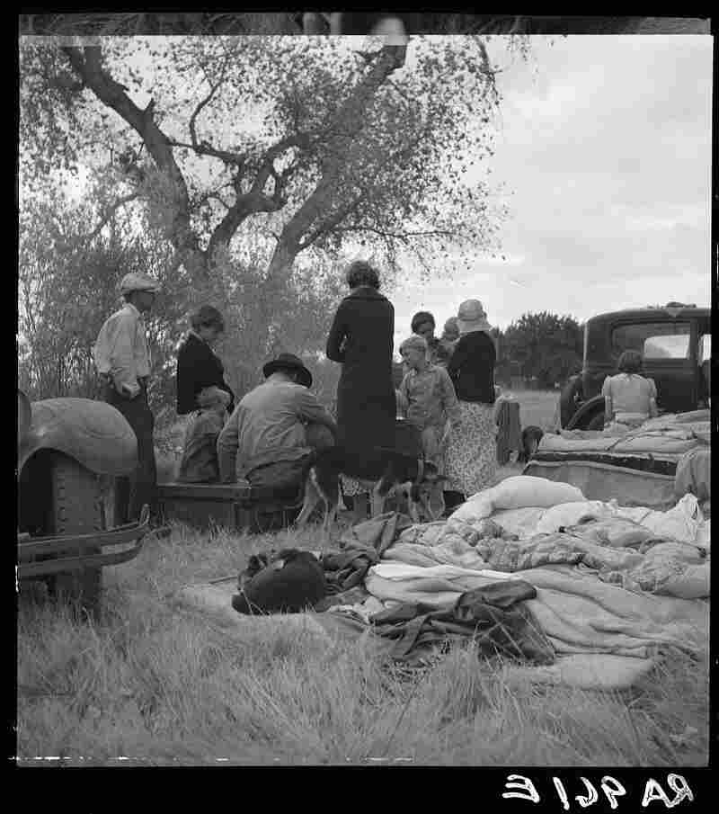 "Dust Bowl refugees camp along a highway near Bakersfield, Calif. (1935). Steinbeck's matriarch, Ma, says, ""All we got is the family unbroke ... I aint scared while we're all here, all that's alive, but I ain't gonna see us bust up."""