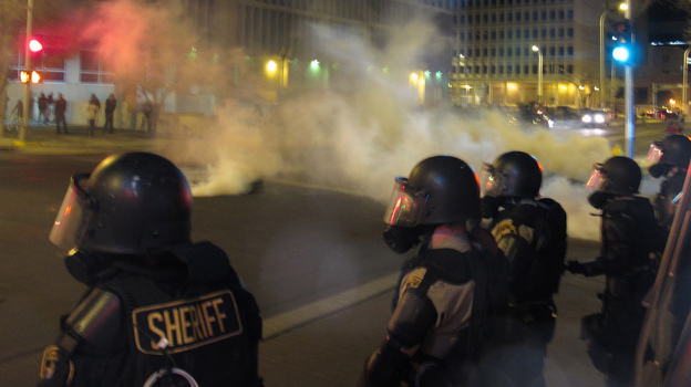 Riot police launch tear gas toward activists in downtown Albuquerque, N.M., last month following a 10-hour protest around the city, in response to a deadly police shooting. (AP)