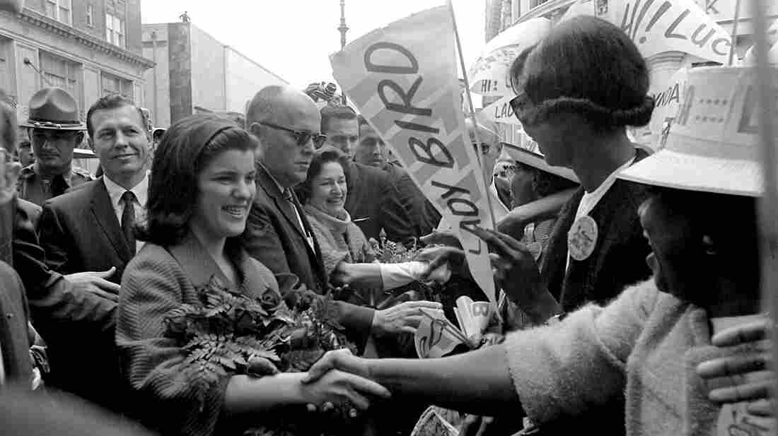 Luci Baines Johnson greets residents as she accompanies her mother, Lady Bird Johnson, to Savannah, Ga., on Oct. 8, 1964.