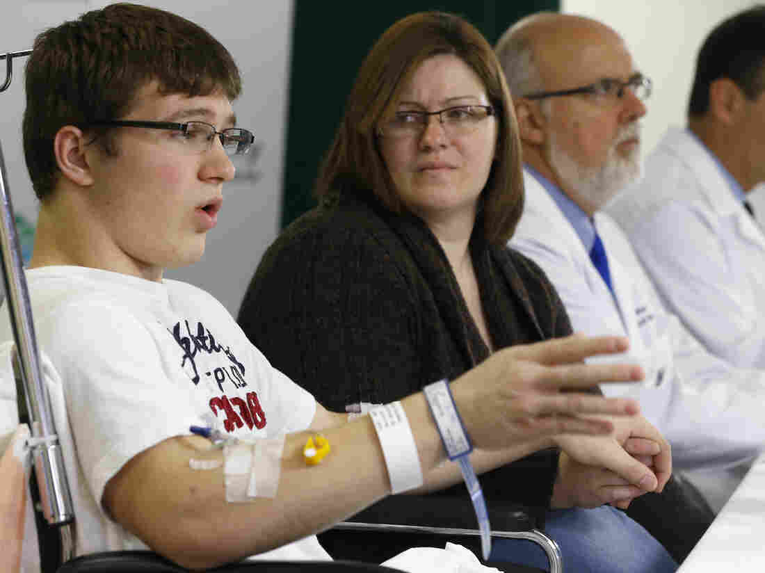 Brett Hurt, 16, a sophomore at Franklin Regional High School in Murrysville, Pa., and a victim of the stabbings there Wednesday, talks with reporters about what happened. With him is his mother, Amanda Hurt, and some of the doctors at Forbes Regional Hospital in Monroeville, Pa.