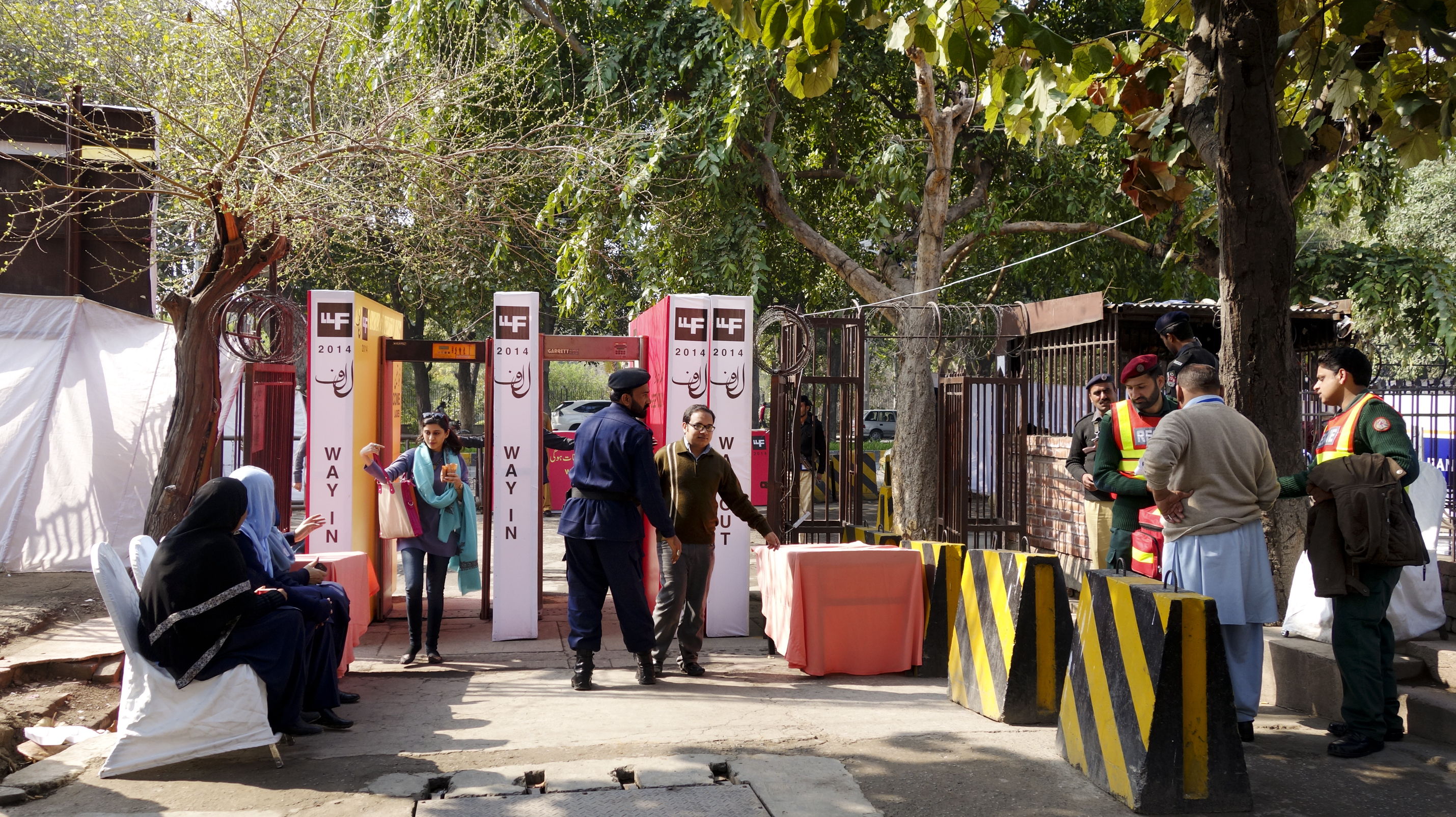 The entrance to the 2014 Lahore Literary Festival is marked by perimeter walls, armed guards and metal detectors.