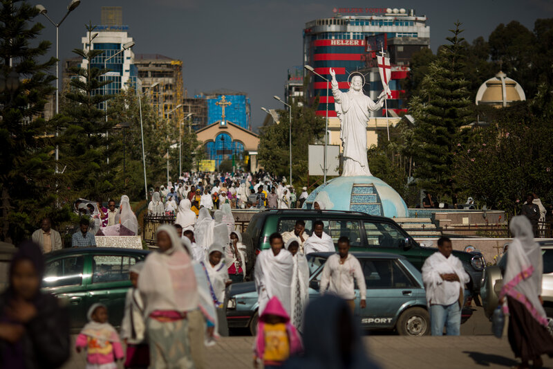 Worshippers stream through downtown Addis Ababa, Ethiopia, toward Bole Medhane Alem (Savior of the World) Cathedral, the largest Orthodox church in Africa.