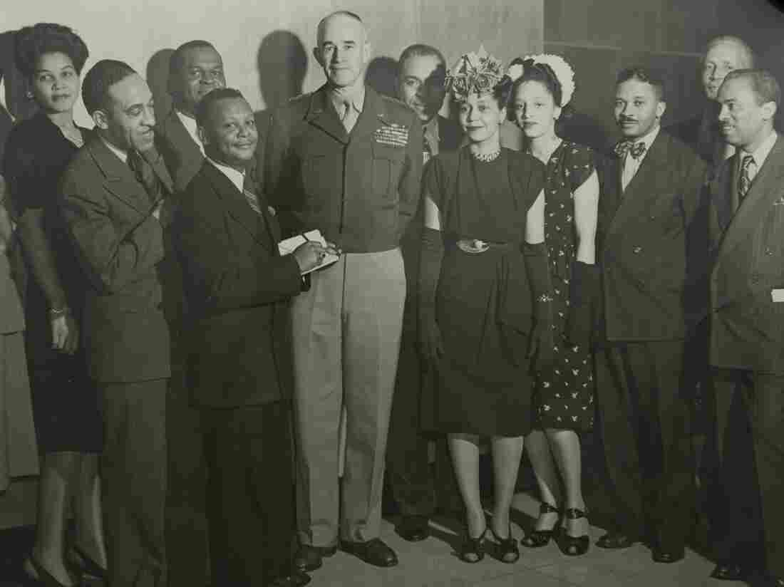 Harry McAlpin was the first black reporter to cover a presidential news conference. He is the third from the right in this group photo featuring U.S. Army Gen. Omar Bradley (center).