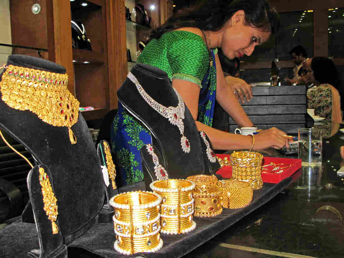 The R.C. Jewelry Store in New Delhi. Indian women have always treasured gold for its beauty and for providing a measure of social security. Today it is also being used to give them a larger say in the family's finances.