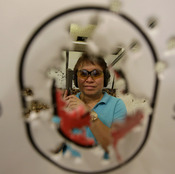 Bureau of Internal Revenue Commissioner Kim Henares poses with her score following target practice in a firing range at suburban Mandaluyong city. (AP Photo/Bullit Marquez)