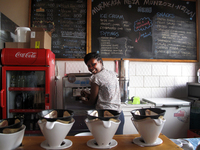 Manager Louise Ingabire fills an order for Belgian chocolate/banana swirl.