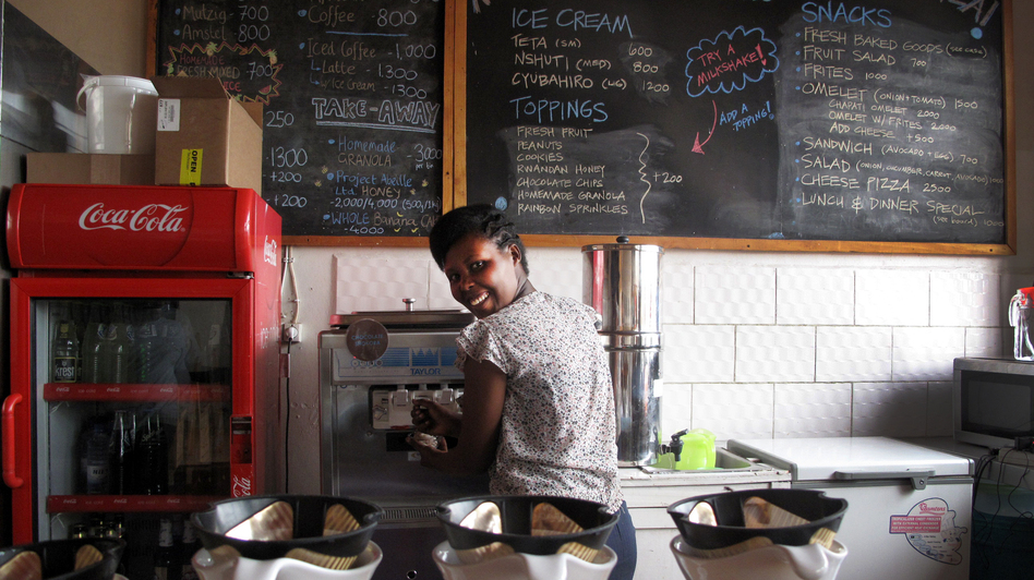 "Manager Louise Ingabire fills an order for Belgian chocolate/banana swirl. ""We were the first women drummers in Rwanda, and now we're the first to bring ice cream,"" she says. ""We would like to change the culture."""