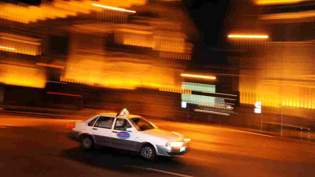 A taxi drives along the historic Bund area in Shanghai on Sept. 15, 2011. For its population of nearly 24 million people, Shanghai has only 50,000 or so cabs.