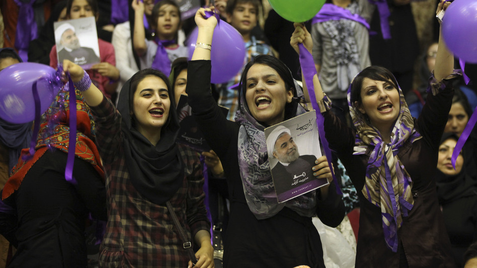 Hasan Rouhani supporters rally for his campaign in the western city of Sanandaj in June 2013. Rouhani pledged to ease social restrictions, but has not taken any major steps since becoming president last summer. (AP)