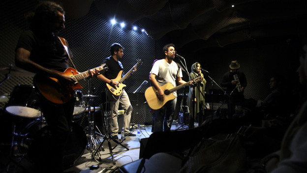 Members of the Iranian band Accolade perform in an unauthorized stage performance in the capital Tehran in January 2013. Those seeking greater social freedoms are often testing the limits in Iran. (AP)