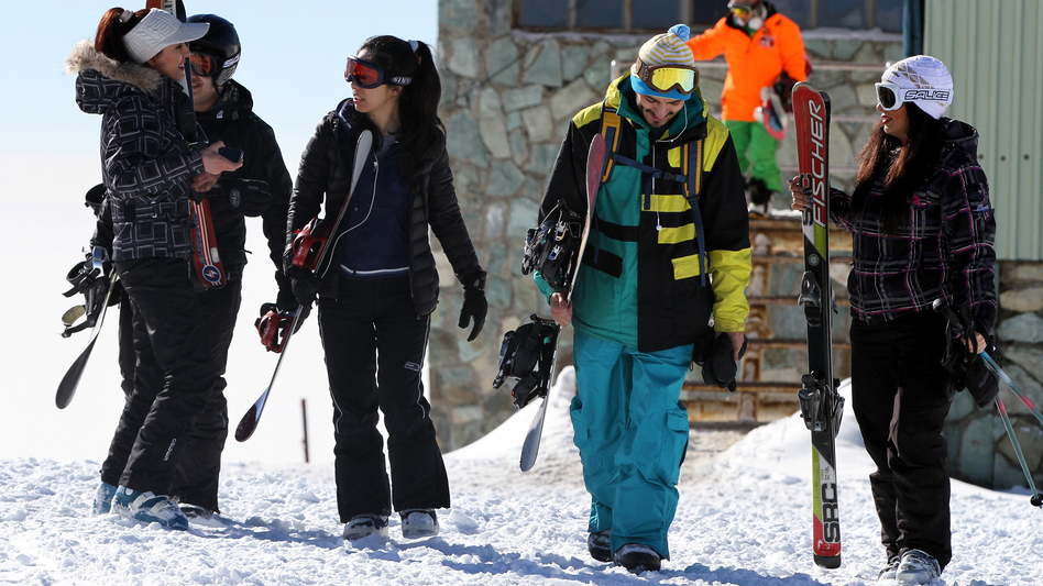 Skiers at a resort in the Alborz mountains near the capital Tehran in January. Men and women used to ski separately in Iran. In recent years, they have been skiing together, though it is not formally authorized. (Anadolu Agency/Getty Images)
