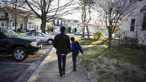 Alicia Montgomery walks with her son near their home.